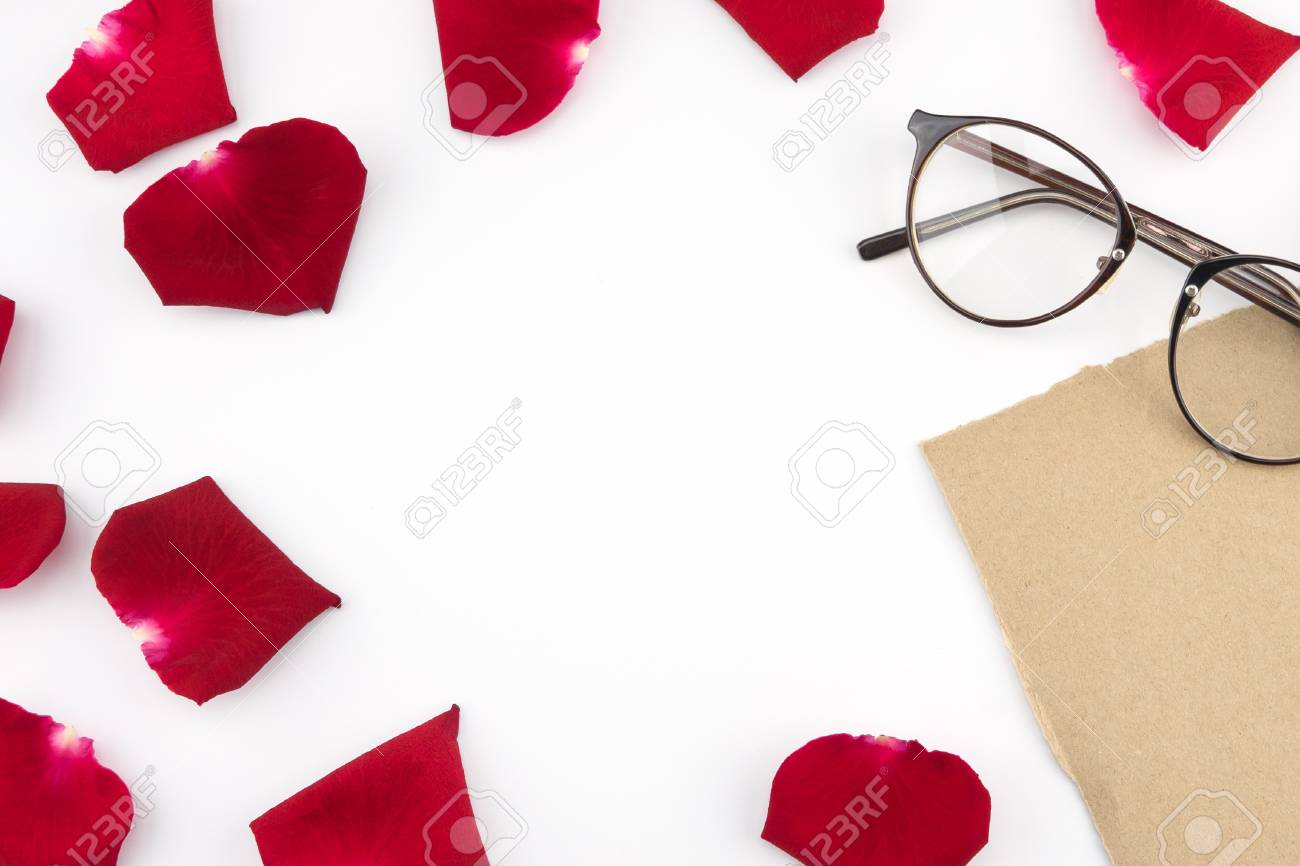 3dabbf0fd3f Blank brown card and glasses decorated with red rose petals with copy space  in the center