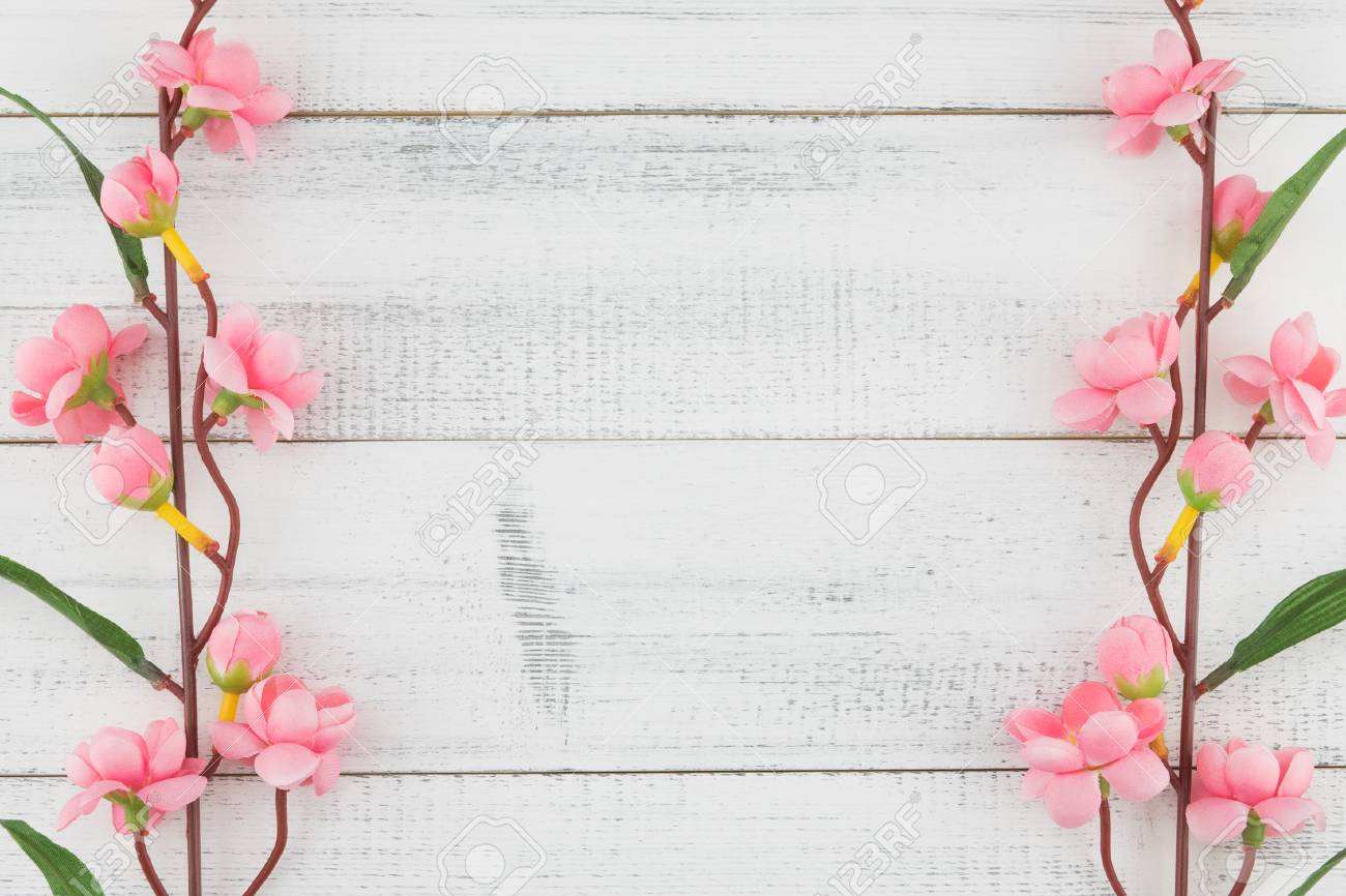 Fake pink flower branches on white wood background with copy stock fake pink flower branches on white wood background with copy space stock photo 95326708 mightylinksfo