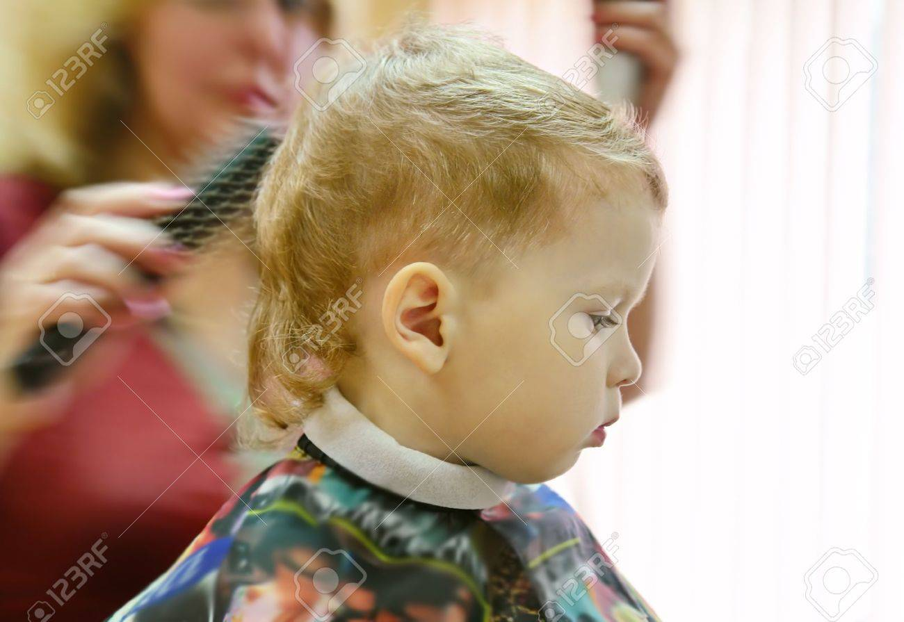 three year old boy getting his hair cut in a hairdressing saloon Stock Photo - 3481163
