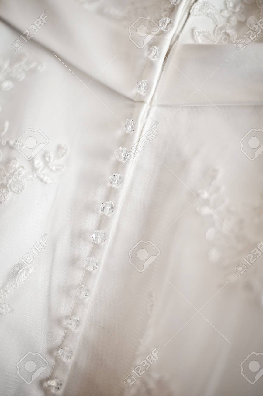 beautiful white wedding dress detail decorated with embroidery (small DOF) Stock Photo - 10963278