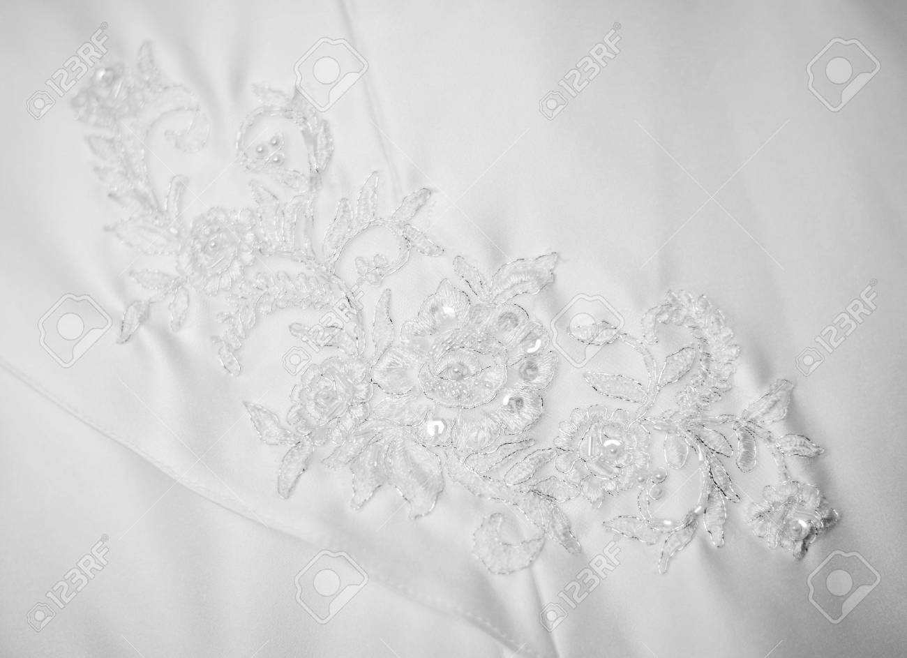 beautiful white wedding dress detail decorated with embroidery (small DOF) Stock Photo - 10963270