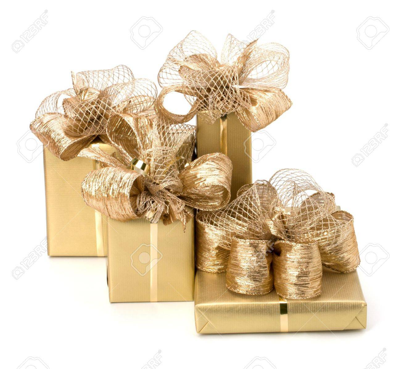 Gold gifts isolated on white background Stock Photo - 8285354