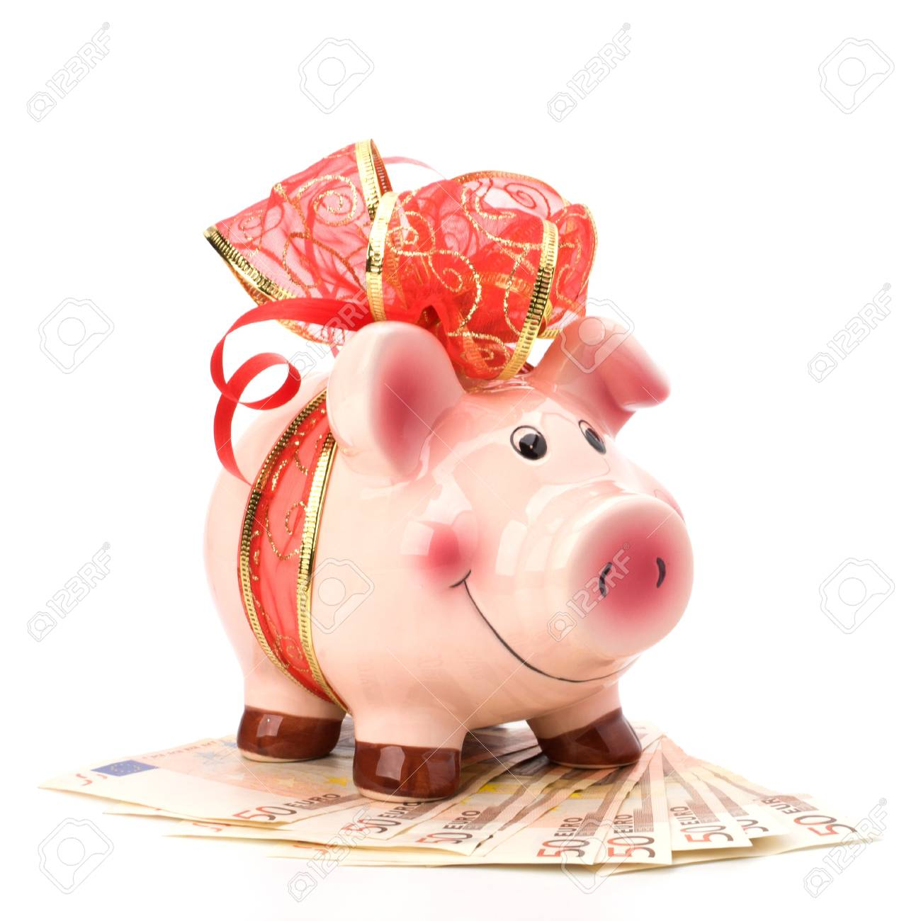 Christmas deposit concept. Piggy bank with festive bow isolated on white. Stock Photo - 8527154