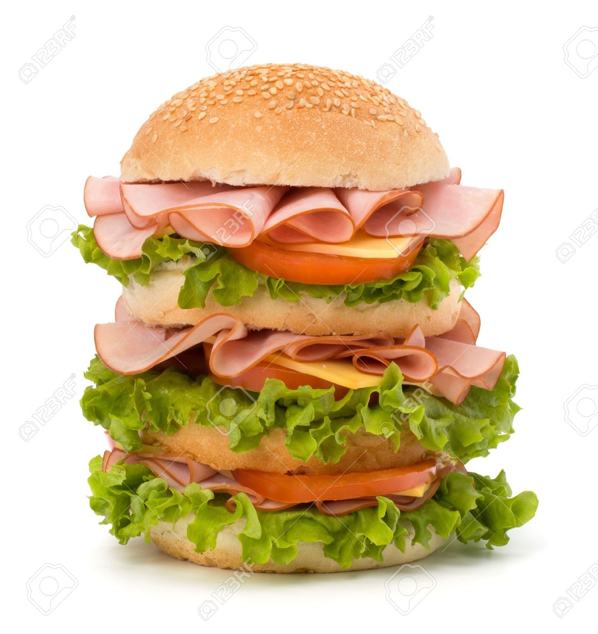 Big appetizing fast food sandwich with lettuce, tomato, smoked ham and cheese isolated on white background. Junk food hamburger. Stock Photo - 9815865