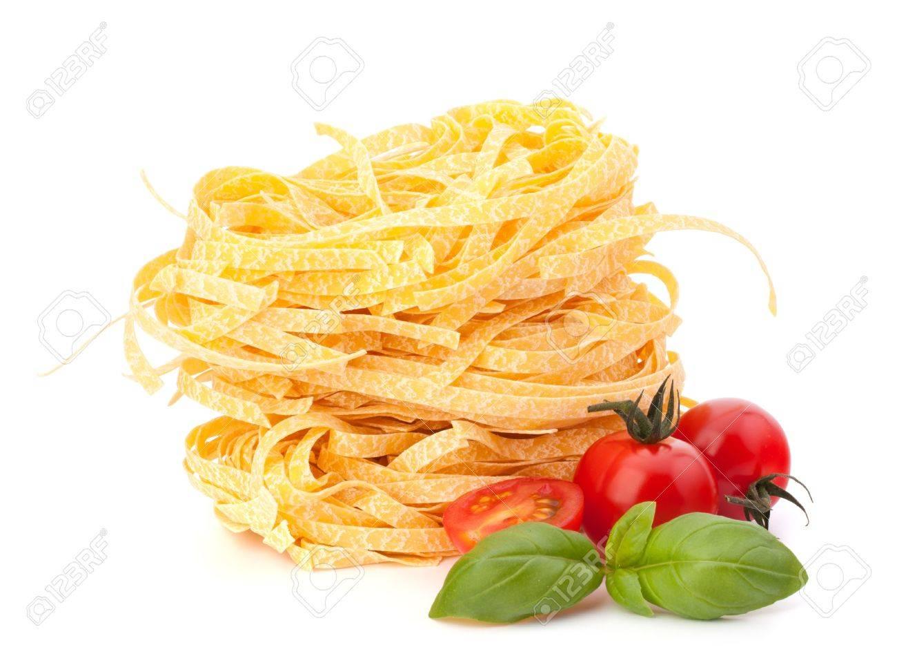 Italian pasta tagliatelle nest and cherry tomato isolated on white background Stock Photo - 13298382