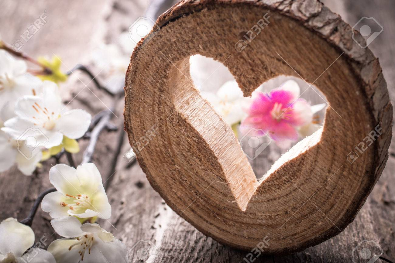 Light heart on rustic wooden background - 35485255