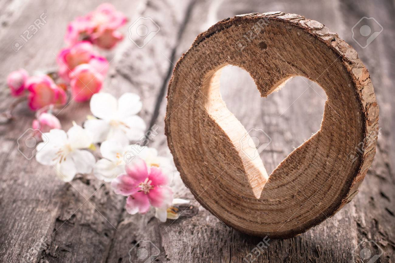 Light heart on rustic wooden background - 39158347