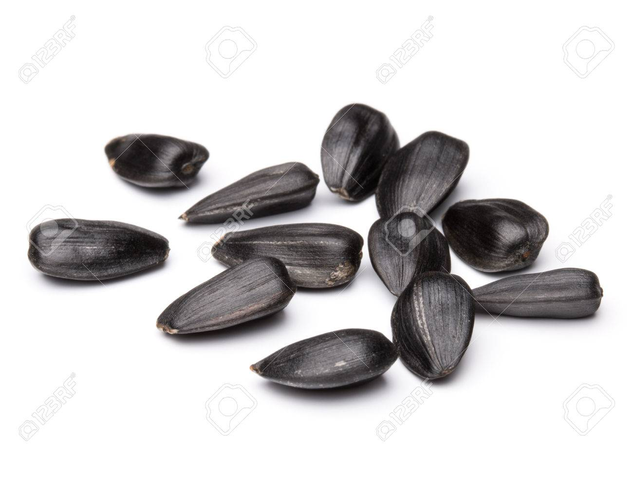 Sunflower seeds isolated on white background close up - 47792332