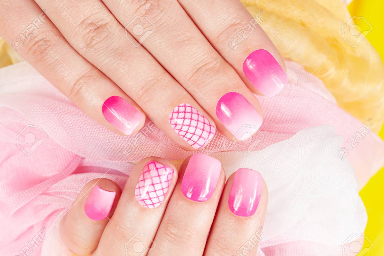 Hands With Manicured Nails Covered With Pink Nail Polish Stock Photo ...