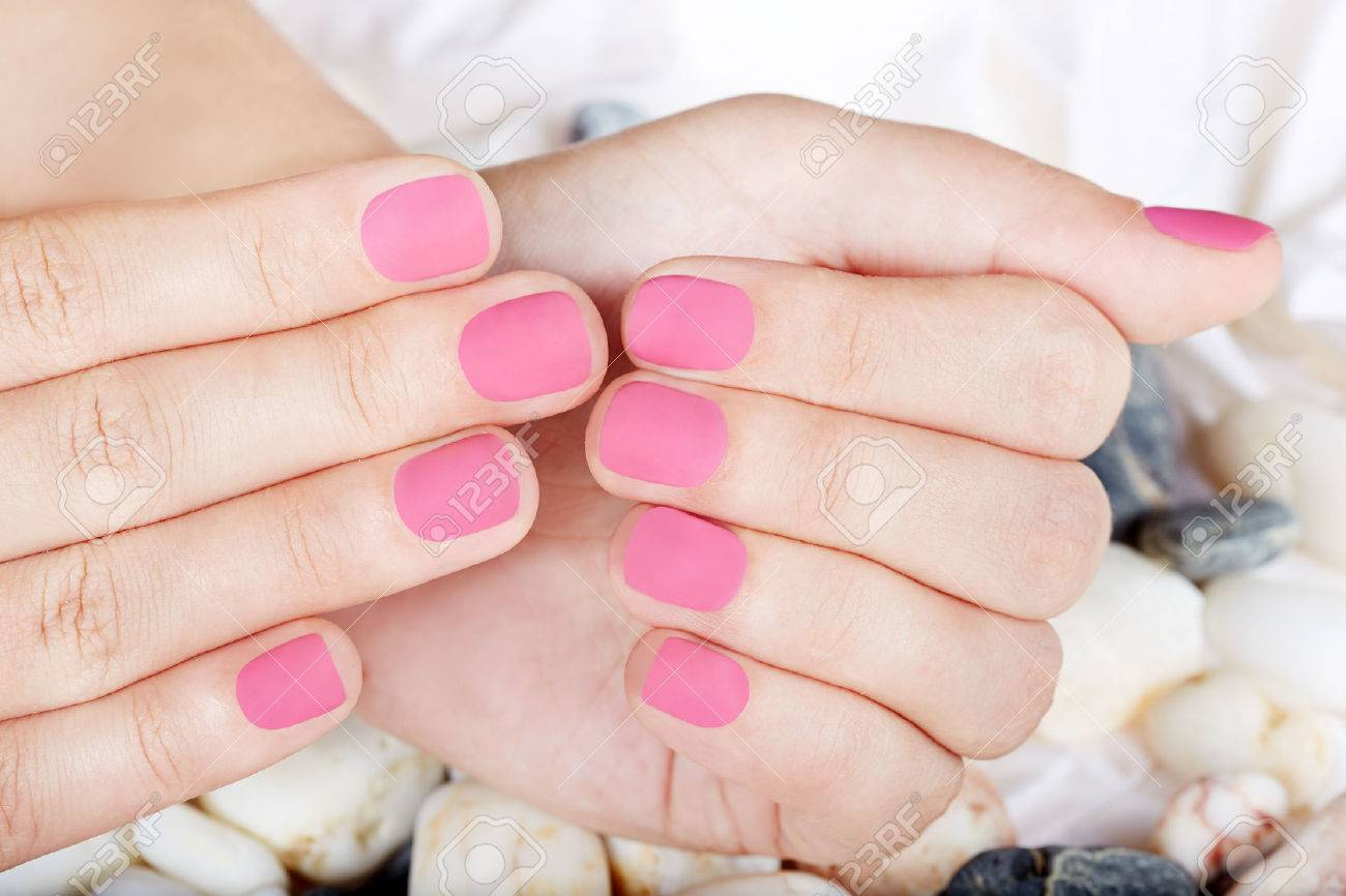 Hands With Pink Matte Manicured Nails Stock Photo, Picture And ...