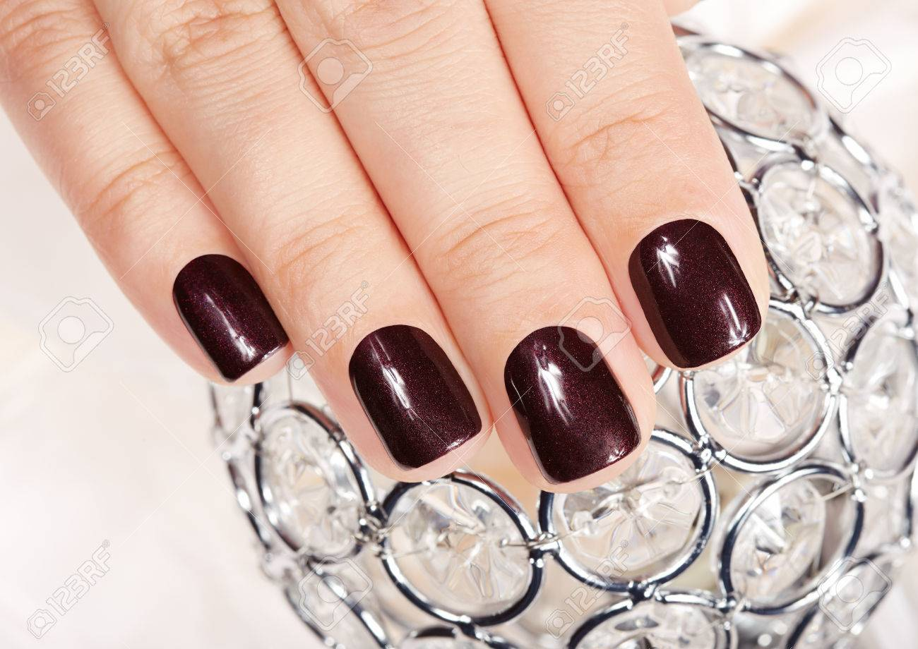Hand With Short Manicured Nails Colored With Dark Purple Nail ...