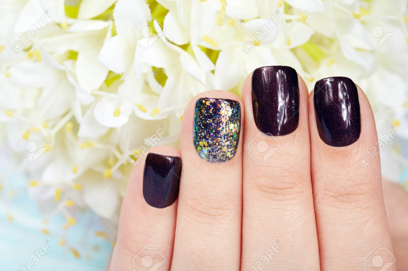 Hand With Manicured Nails Colored With Dark Purple Nail Polish Stock ...