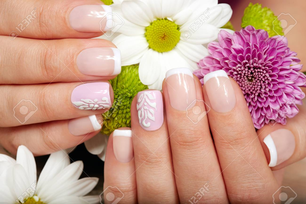 Hands with french manicured nails and a bouquet of flowers stock hands with french manicured nails and a bouquet of flowers stock photo 94264095 izmirmasajfo
