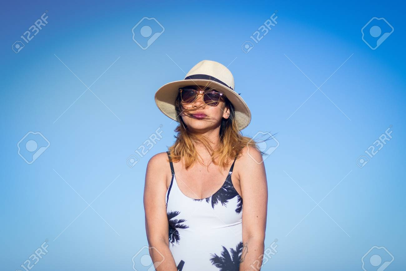 a74bc9de5949d portrait half body of a pregnant woman in swimming suit and wears white  hat, sitting