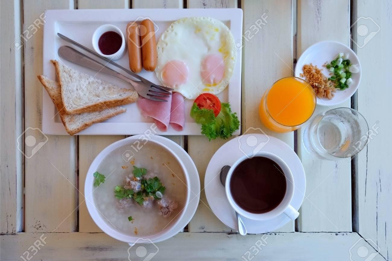 Simple Breakfast Including Eggs Ham Sausage Bread Mush Coffee Orange