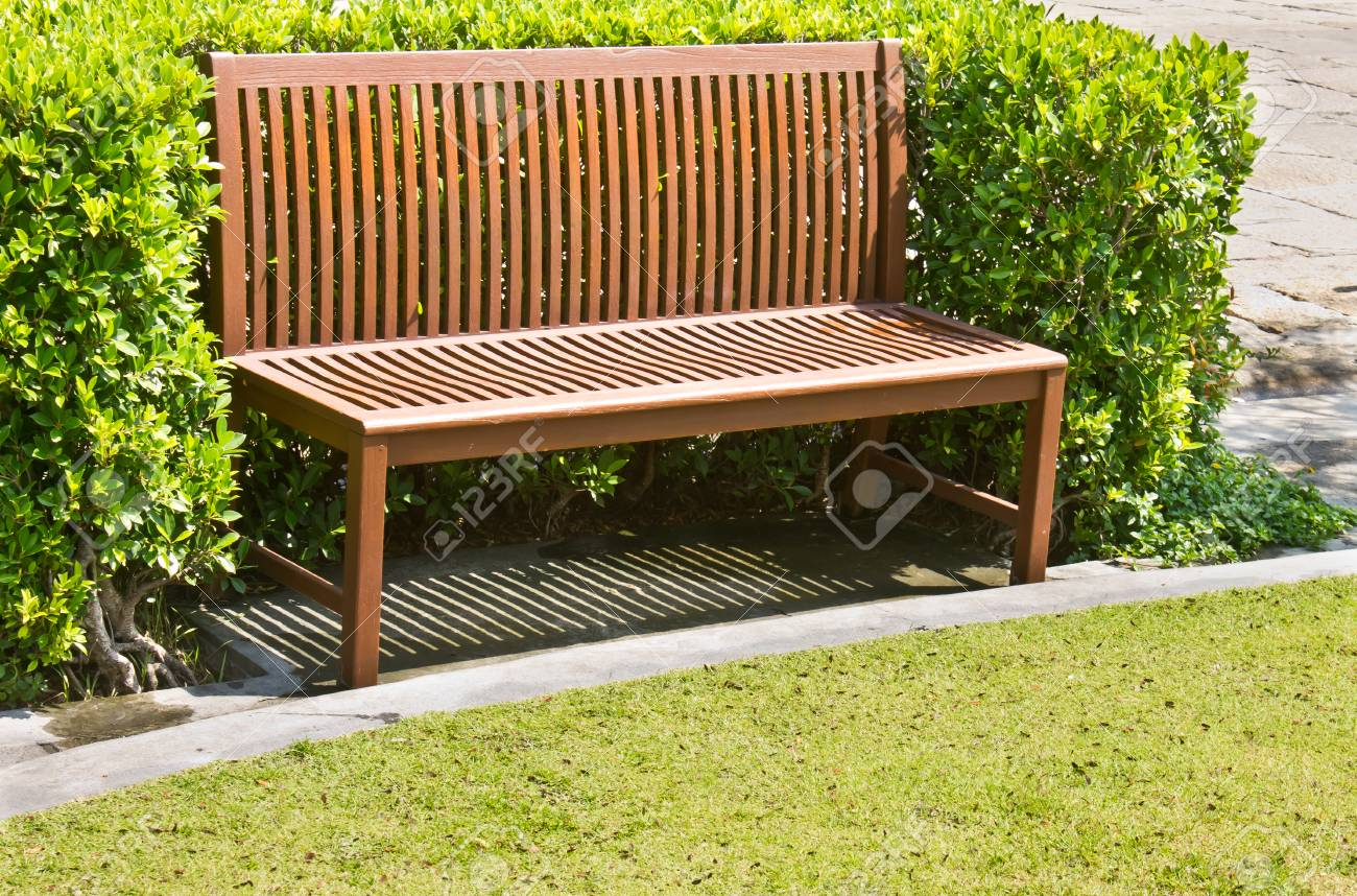Wooden Bench In The Garden Stock Photo, Picture And Royalty Free ...