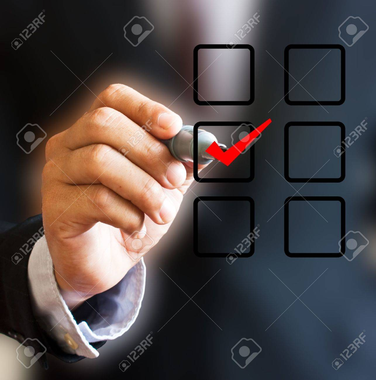 Hand with pen and check box. Stock Photo - 9808196