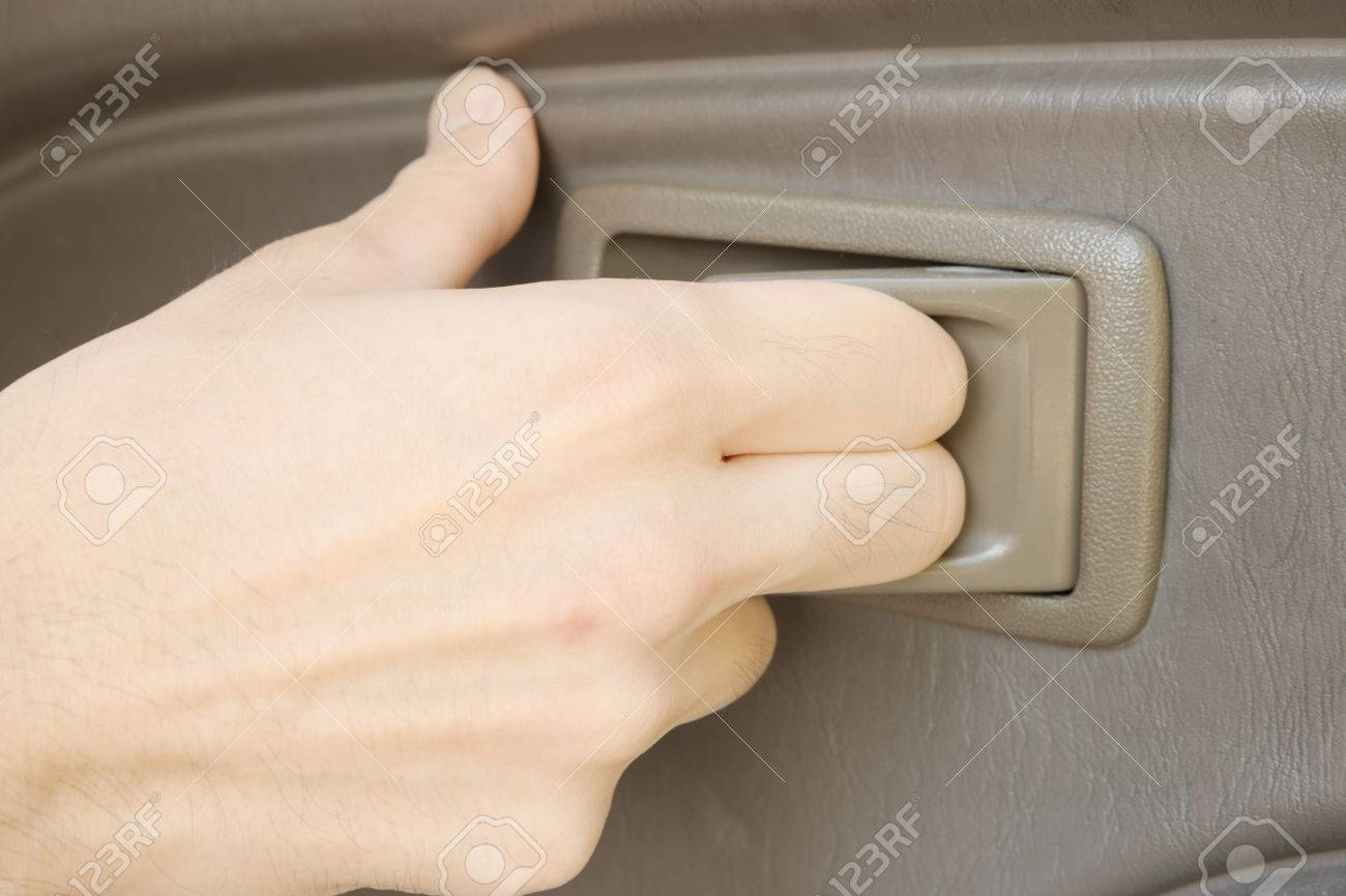 inside car door handle. male hand pulling plastic handle to open car door from inside stock photo 36417769 f