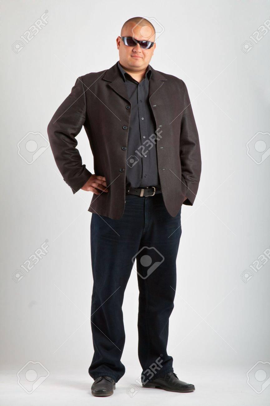 Man in black suit in sun glasses. Stock Photo - 5027945