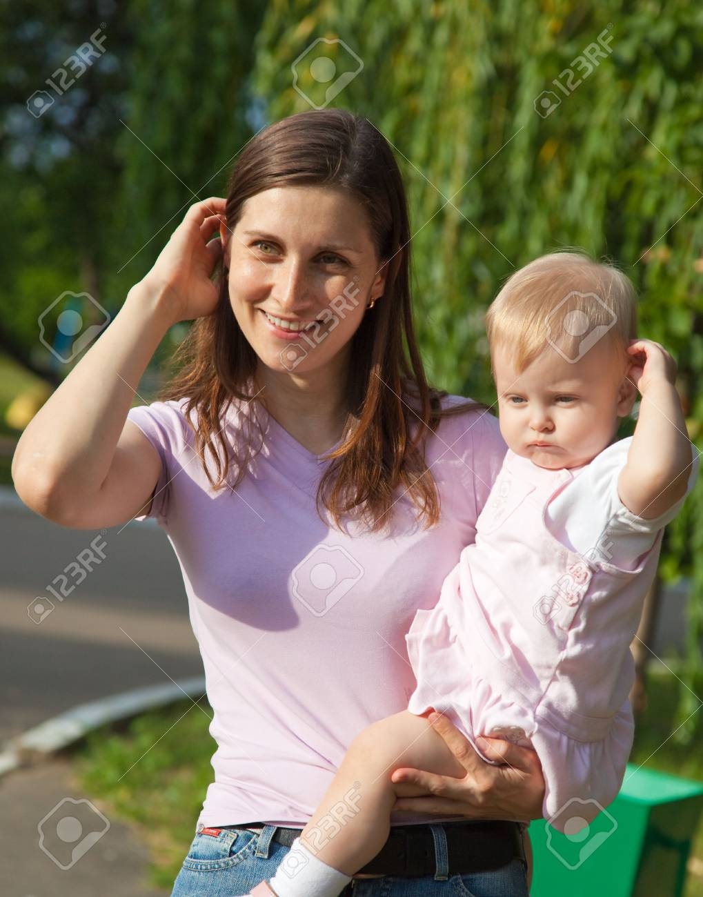 Woman holding her one year old daughter Stock Photo - 5318885