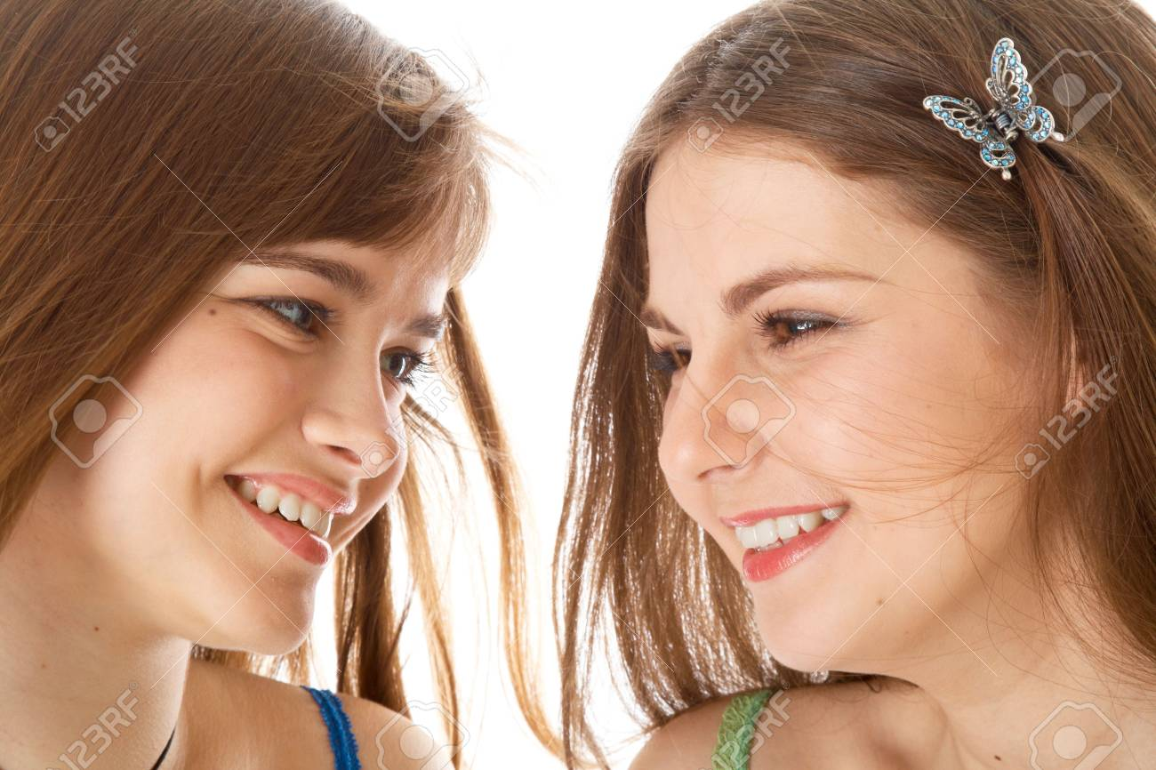 Two laugh teenage girls. Isolated on white background Stock Photo - 5318965
