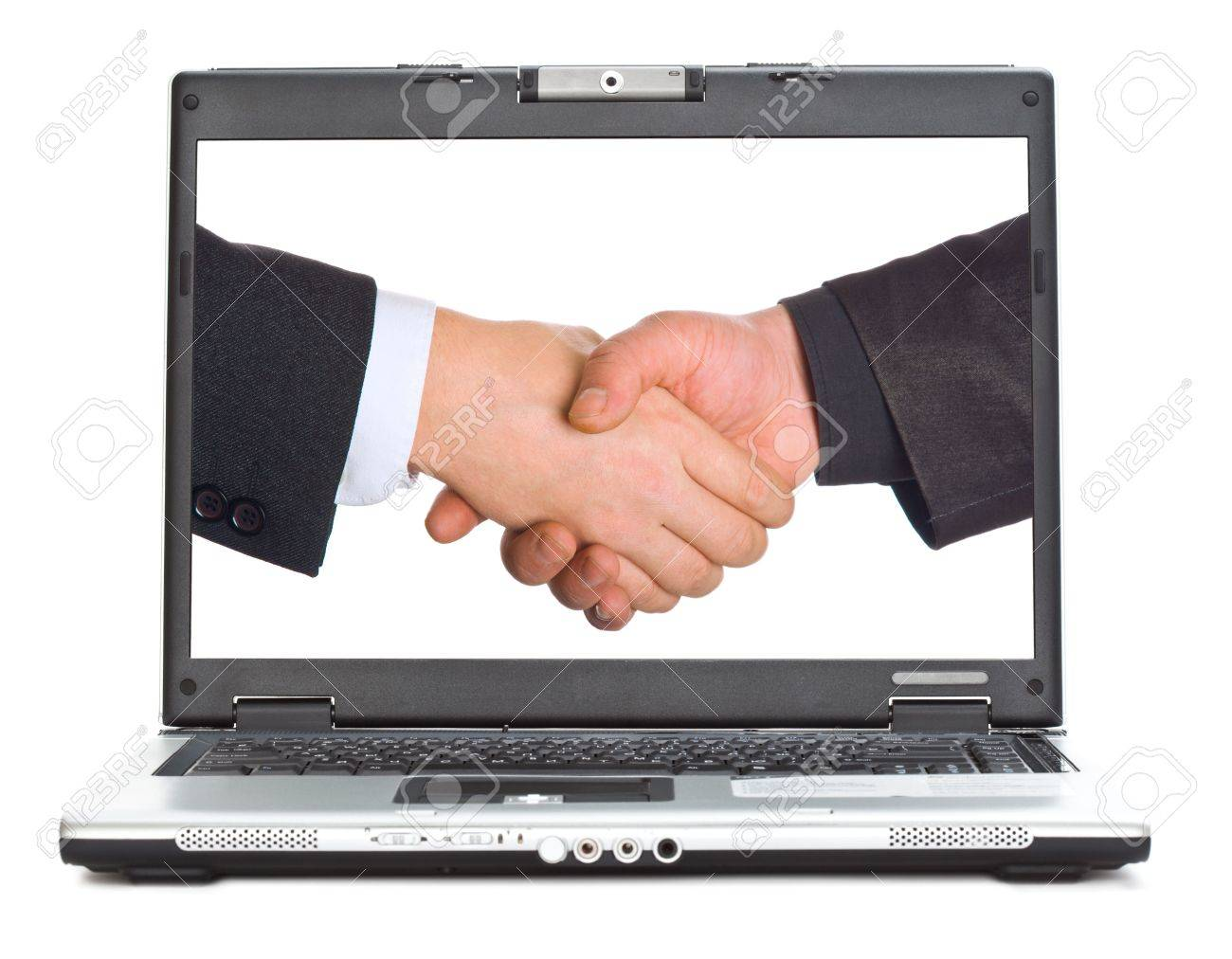 Handshake on a screen of laptop. Isolated on white background Stock Photo - 5884017
