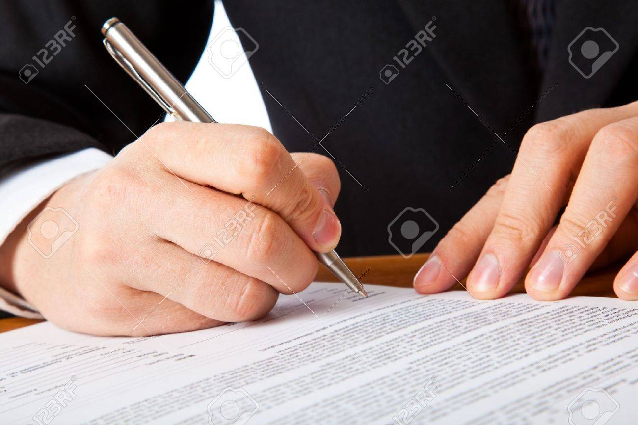 Close up on a businessman hands signing a contract. Isolated on white background Stock Photo - 5971736