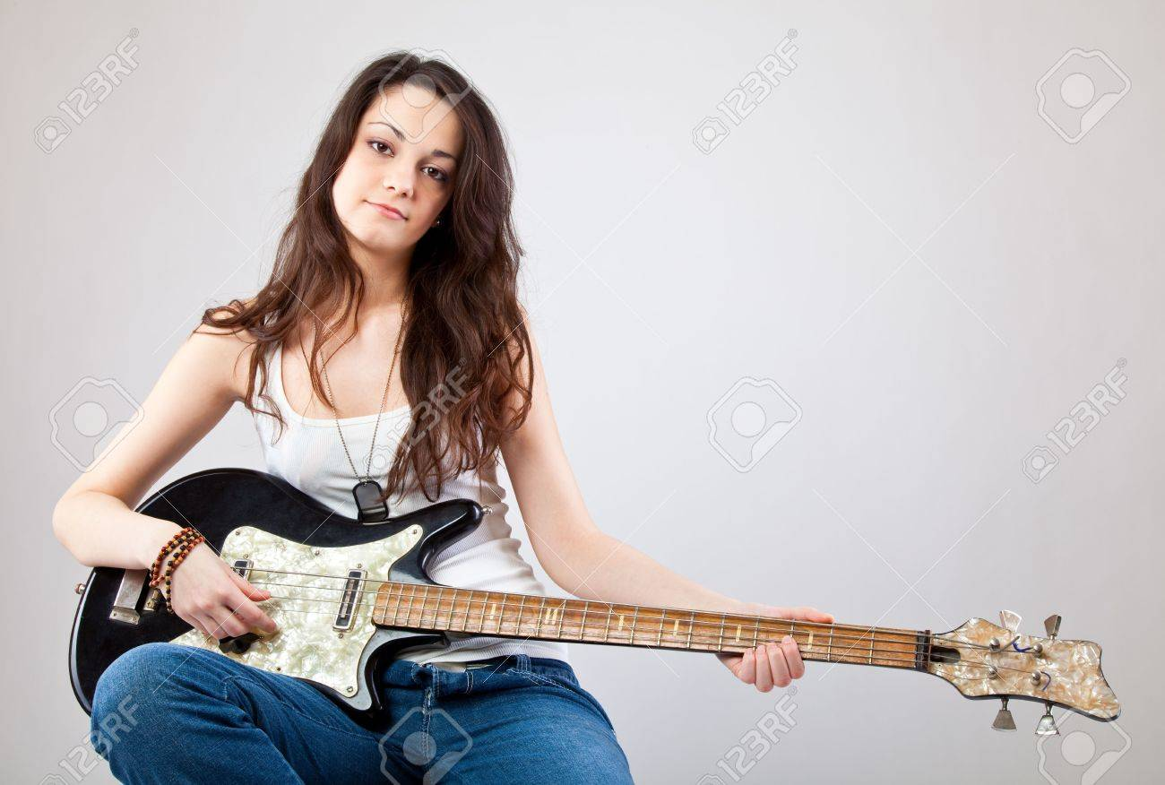 Teenage girl  with electric guitar on gray background Stock Photo - 6678557