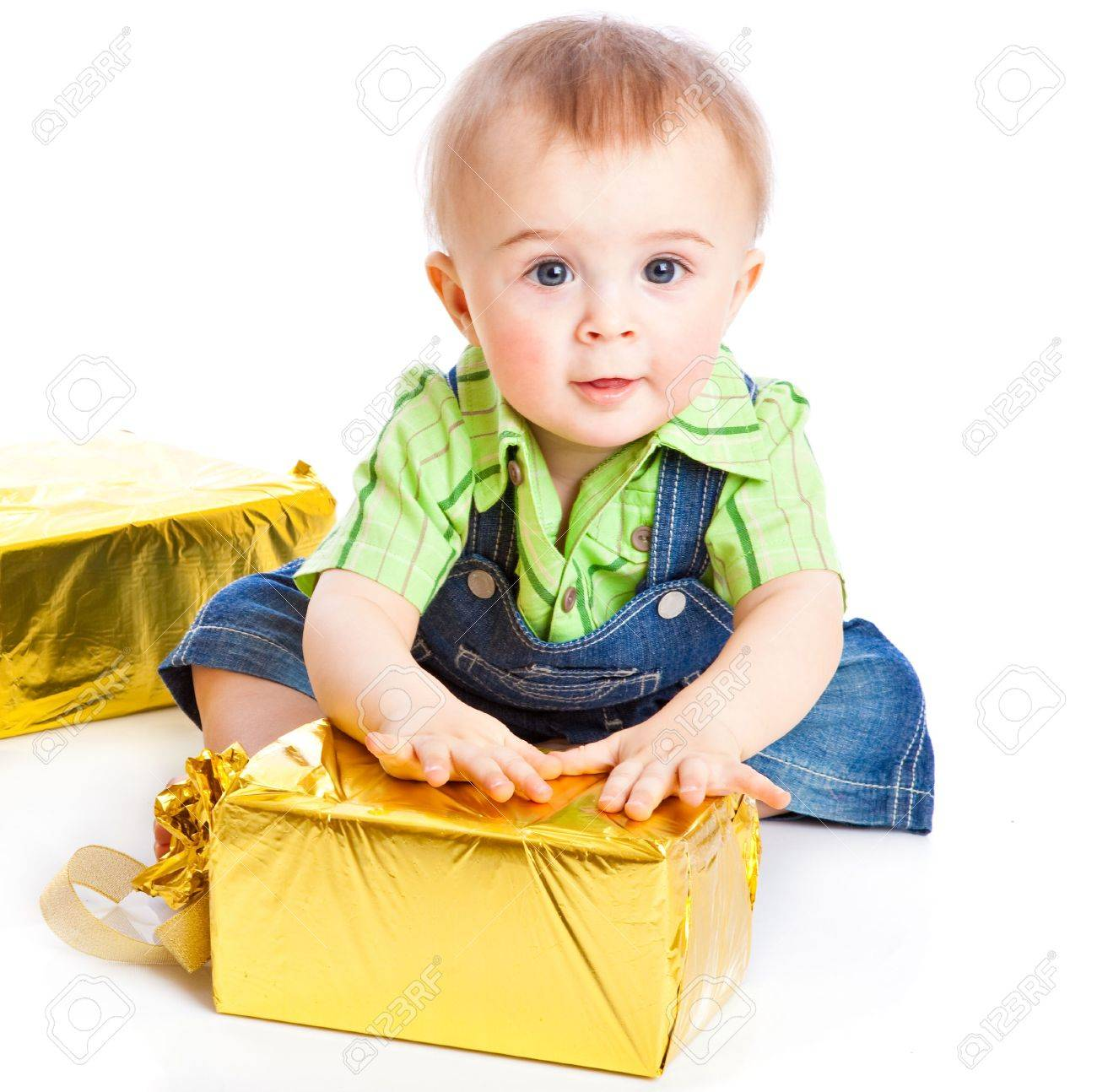 Baby with gifts. Isolated on white background Stock Photo - 6865977