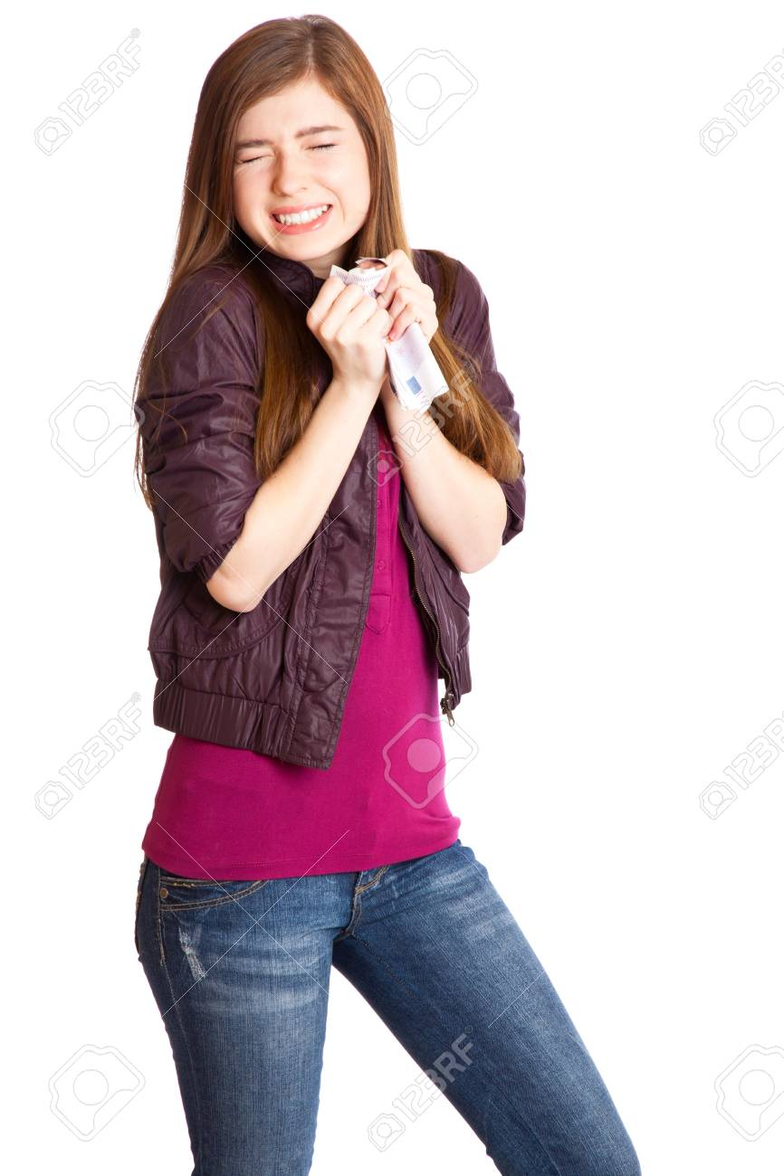 Girl with money in hands. Isolated on white background Stock Photo - 7218657