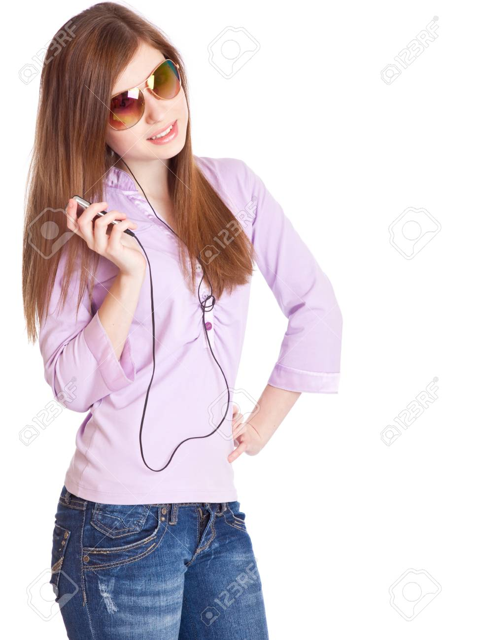 Young girl listening to music om mp3 player. Isolated on white background Stock Photo - 7218648