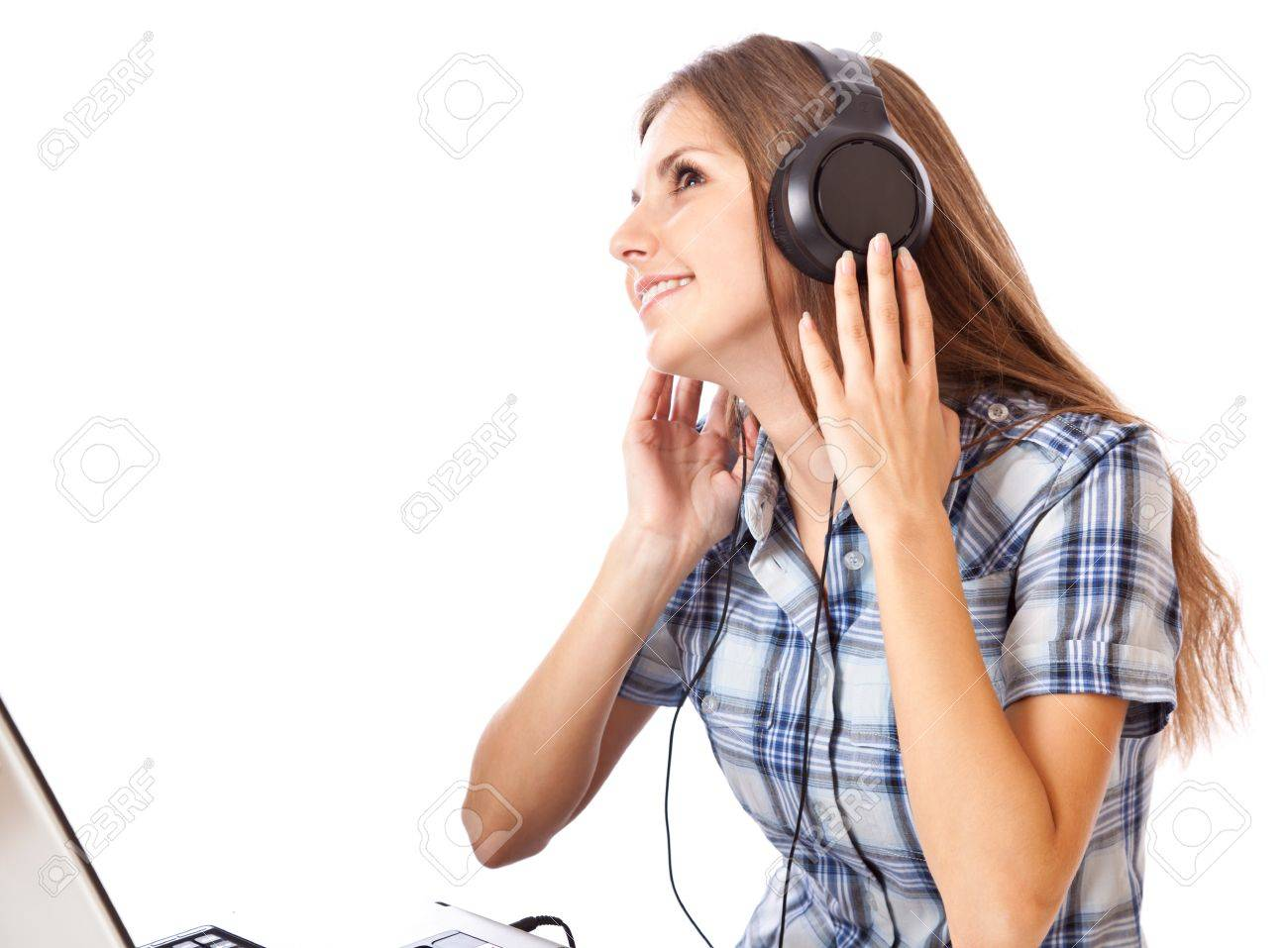 Teen-girl listen to music in headphones with laptop. Isolated on white background Stock Photo - 7923008