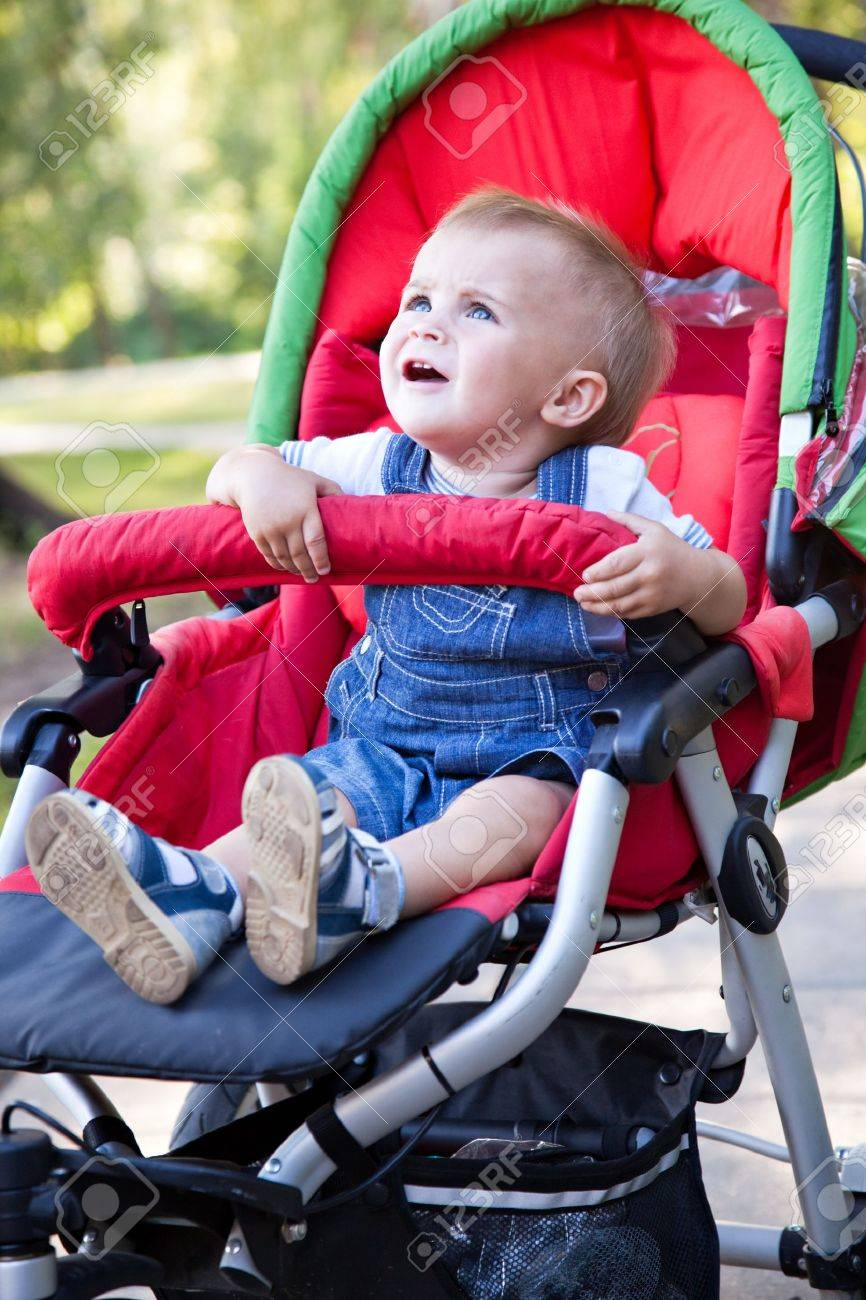 823157b480ed A Resentful Baby Is Crying In The Pram Stock Photo