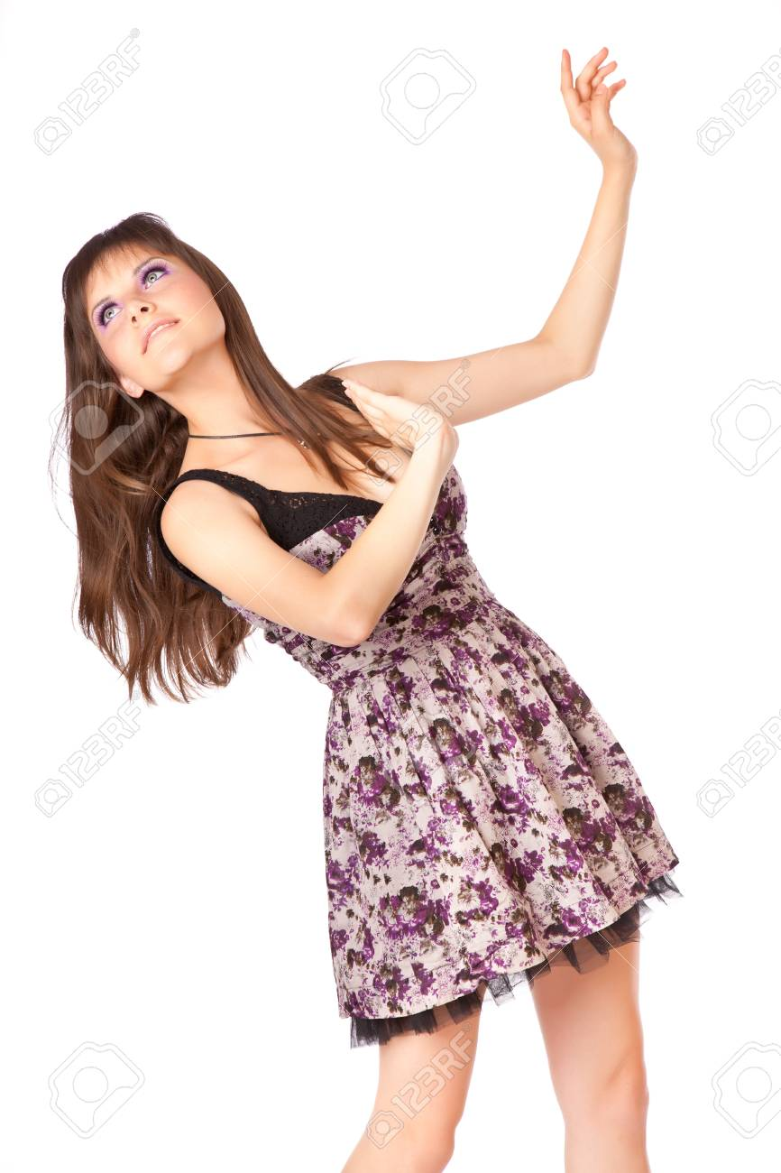 Young woman is putting her hands up. Isolated on white background Stock Photo - 11269893
