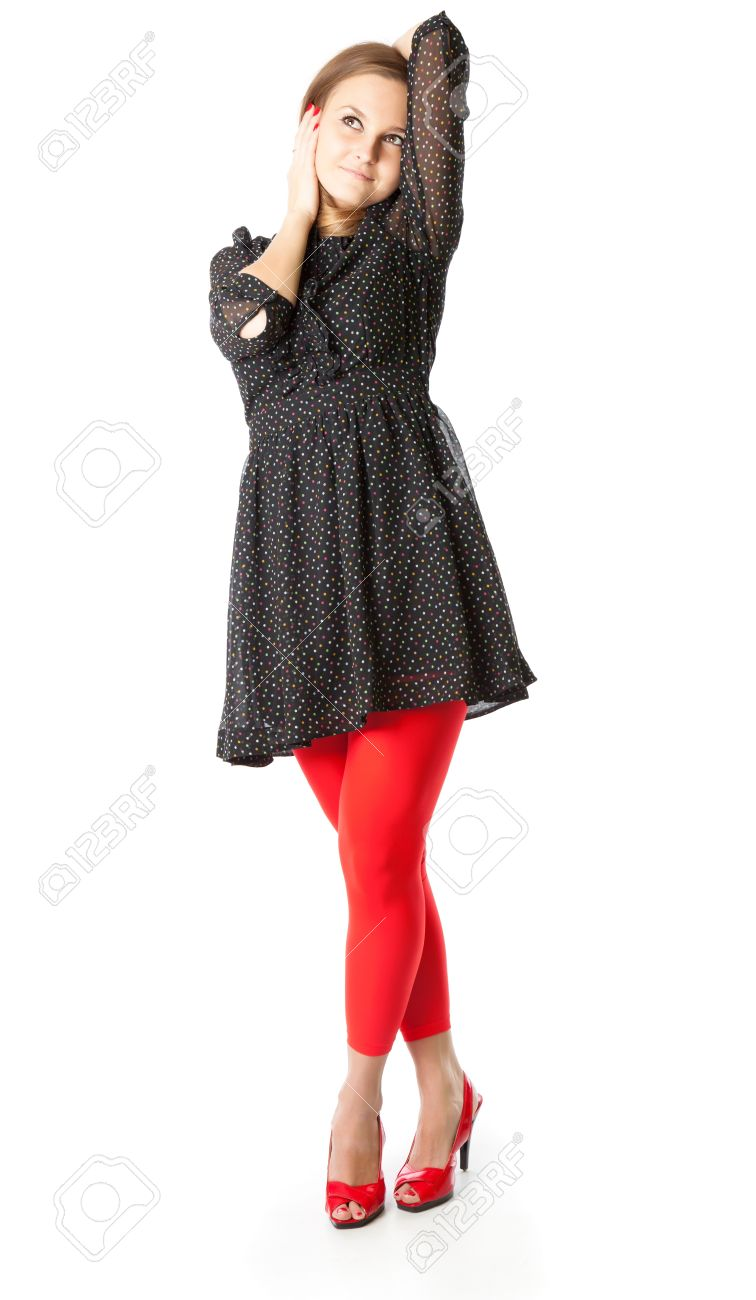 858d9db62 Portrait of teen girl. The girl is wearing black dress and red tights.  Isolated
