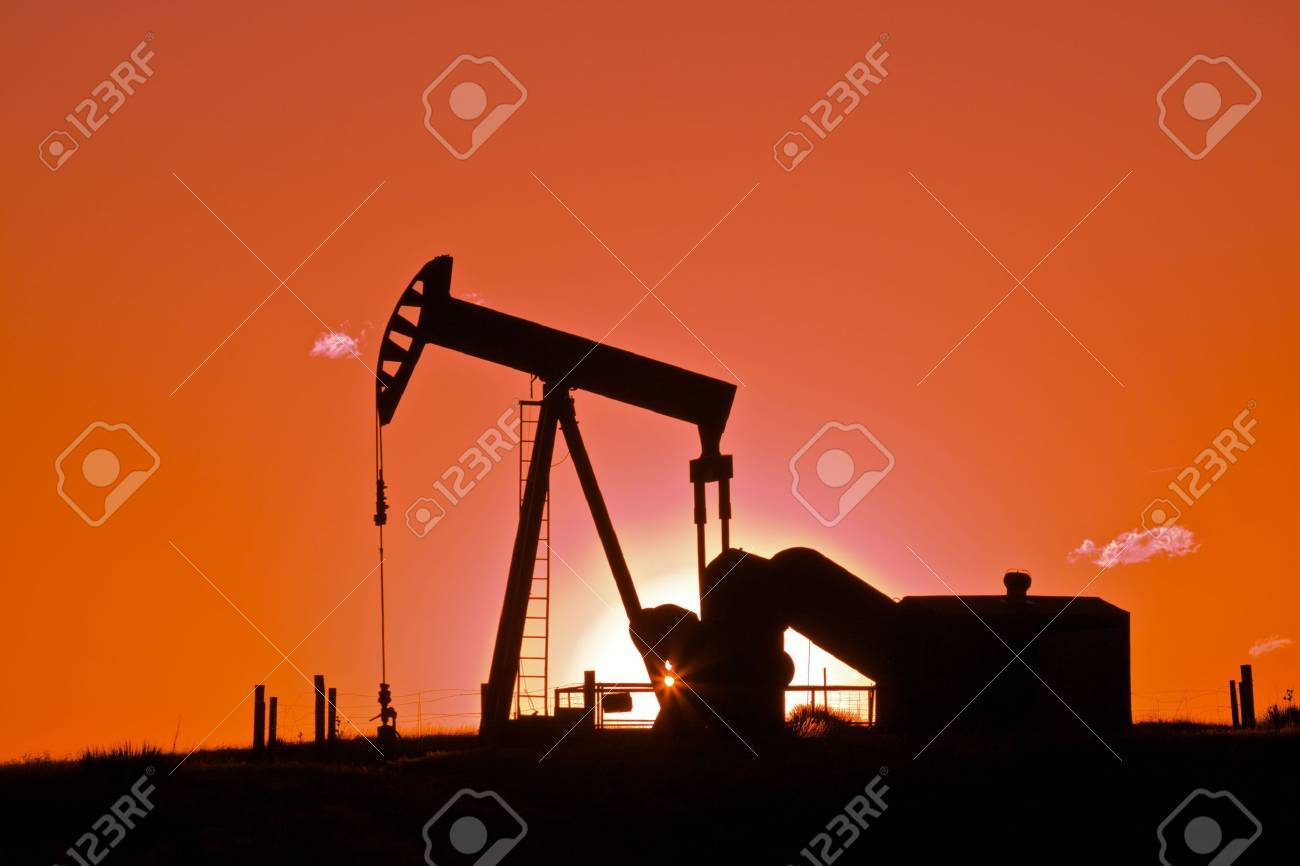 Oil Drilling Rig in Sunset - 7150930