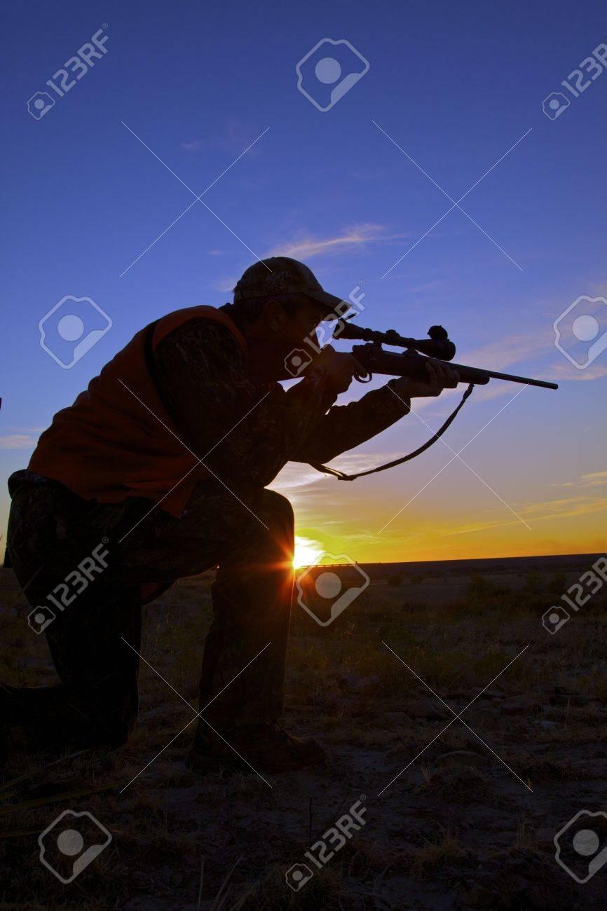 Rifle Hunter in Sunset - 8342803