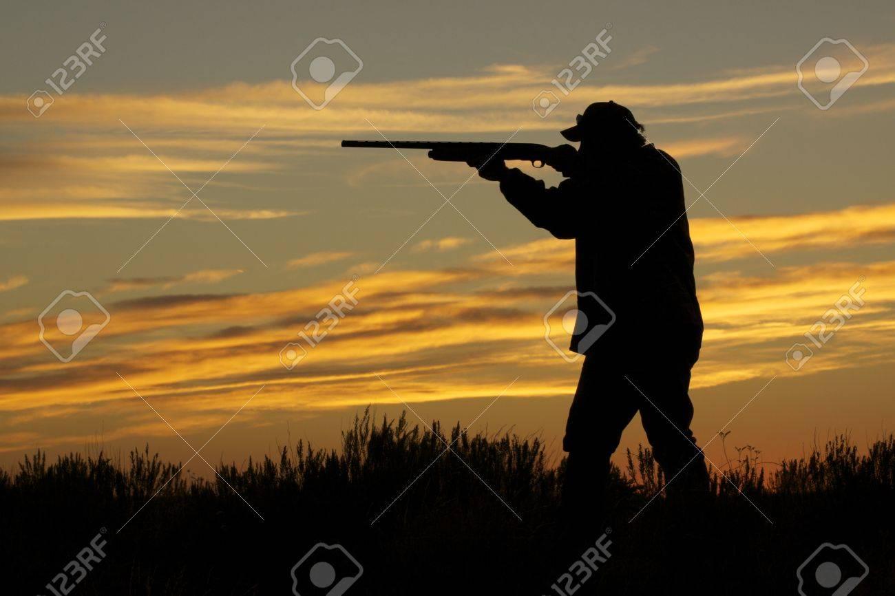 Hunter Shooting at Sunset - 9030561