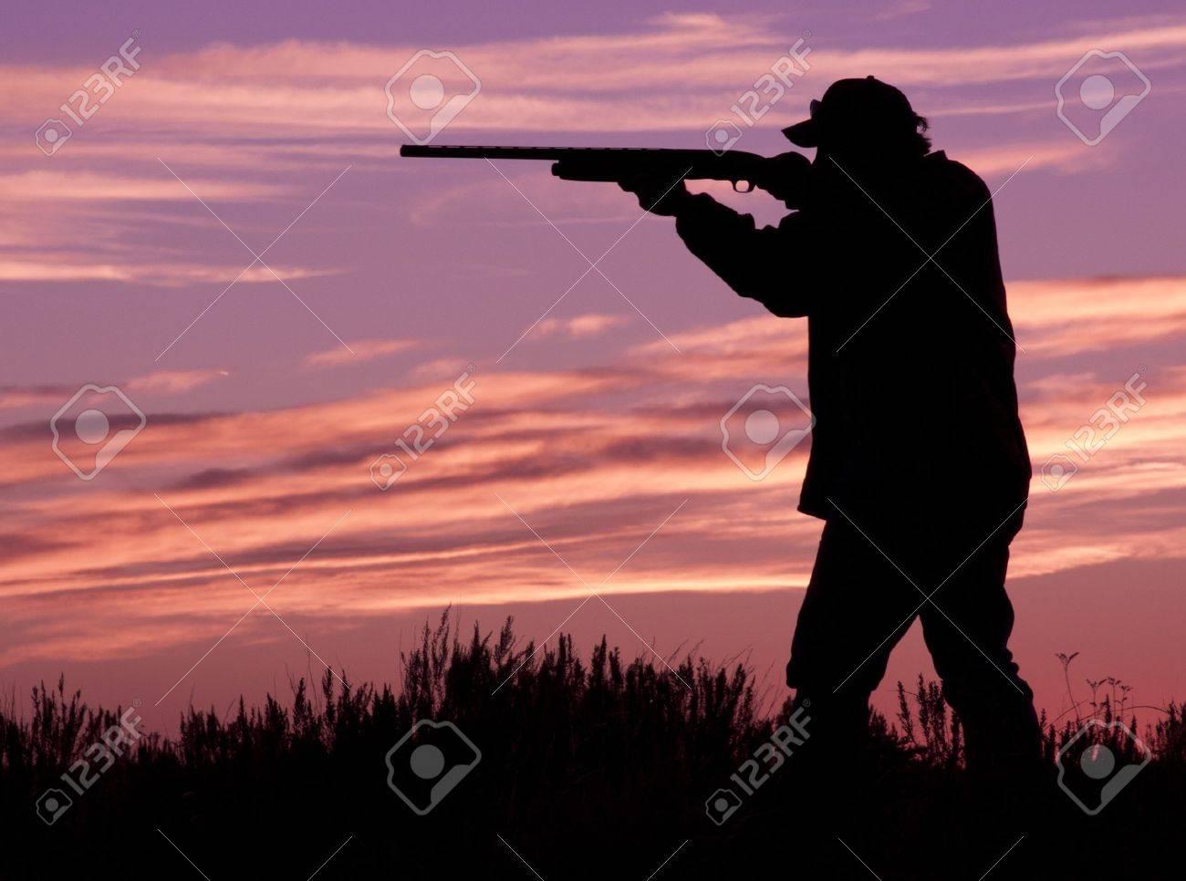 Hunter Shooting at Sunrise - 10920620