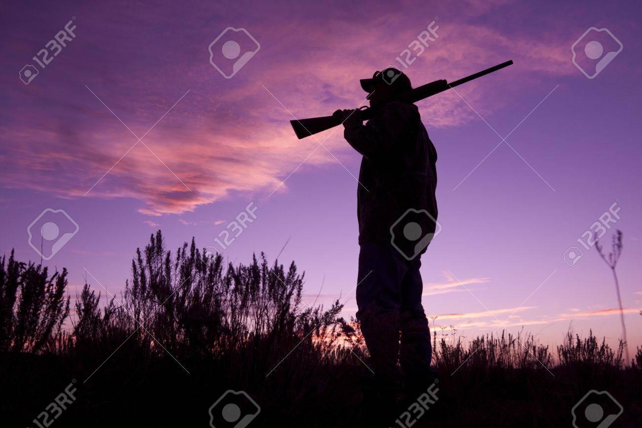Hunter at Ready in Sunrise - 10920628