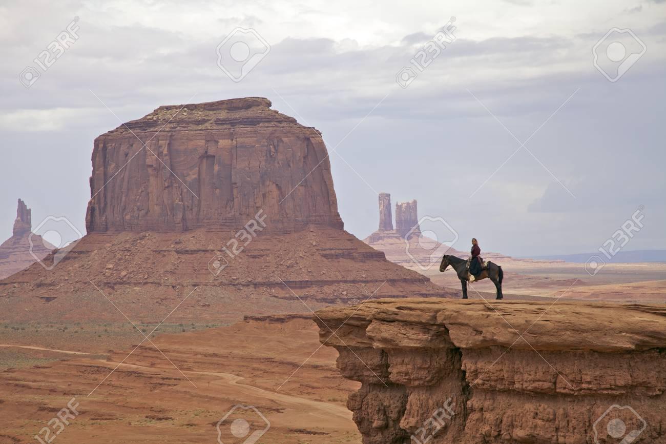 Horseback in Monument Valley - 14431124