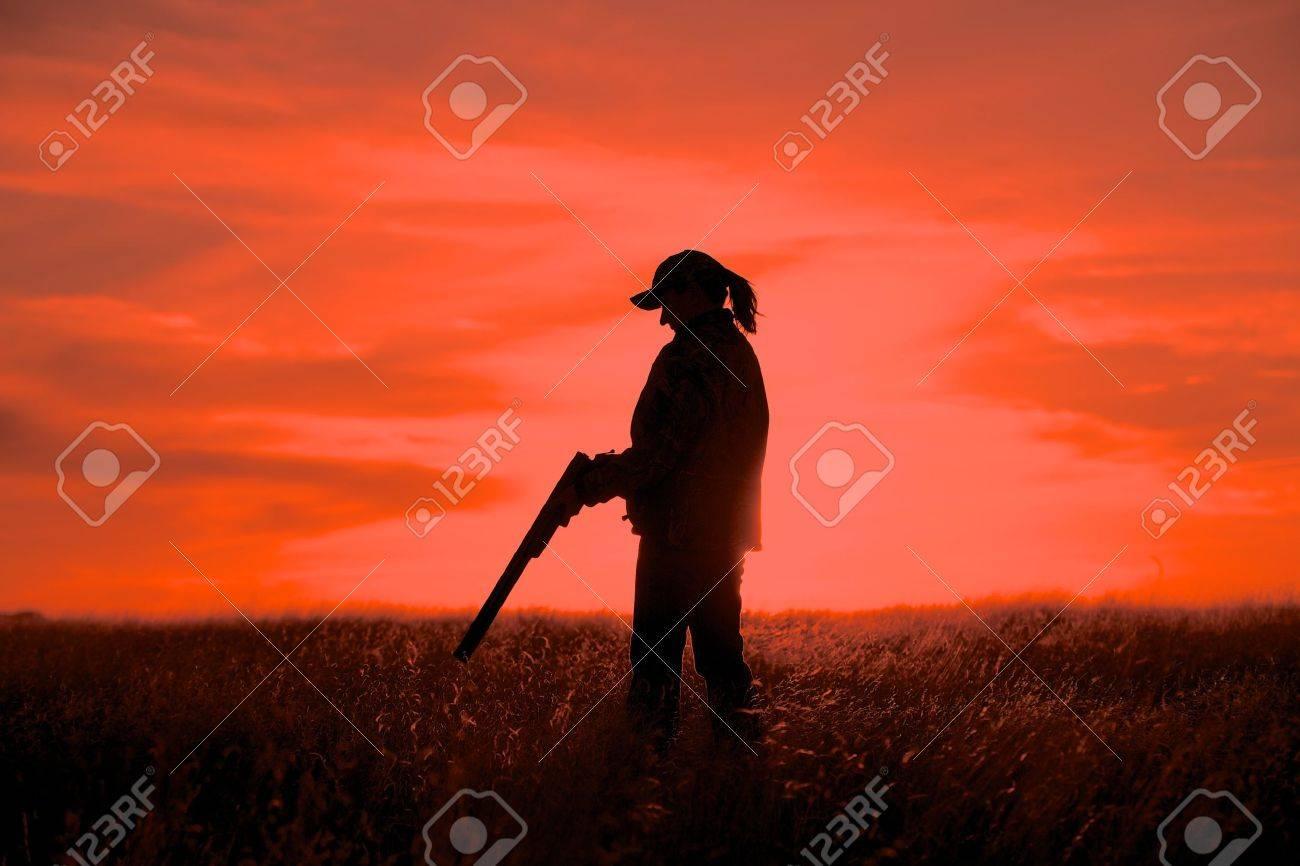Female Upland Game Hunter in Sunset - 18878940