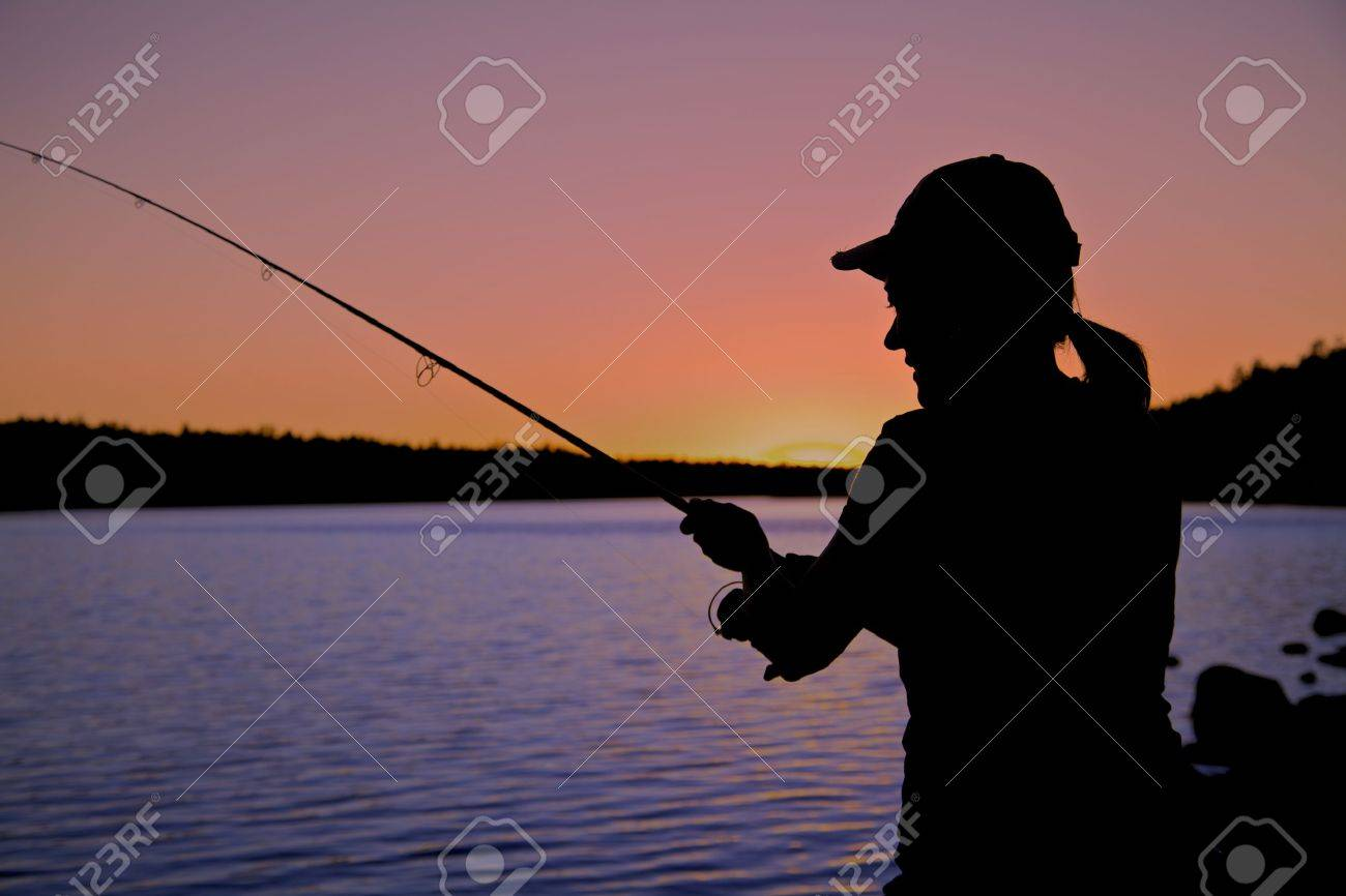 Woman Fishing in the Sunset - 19122065