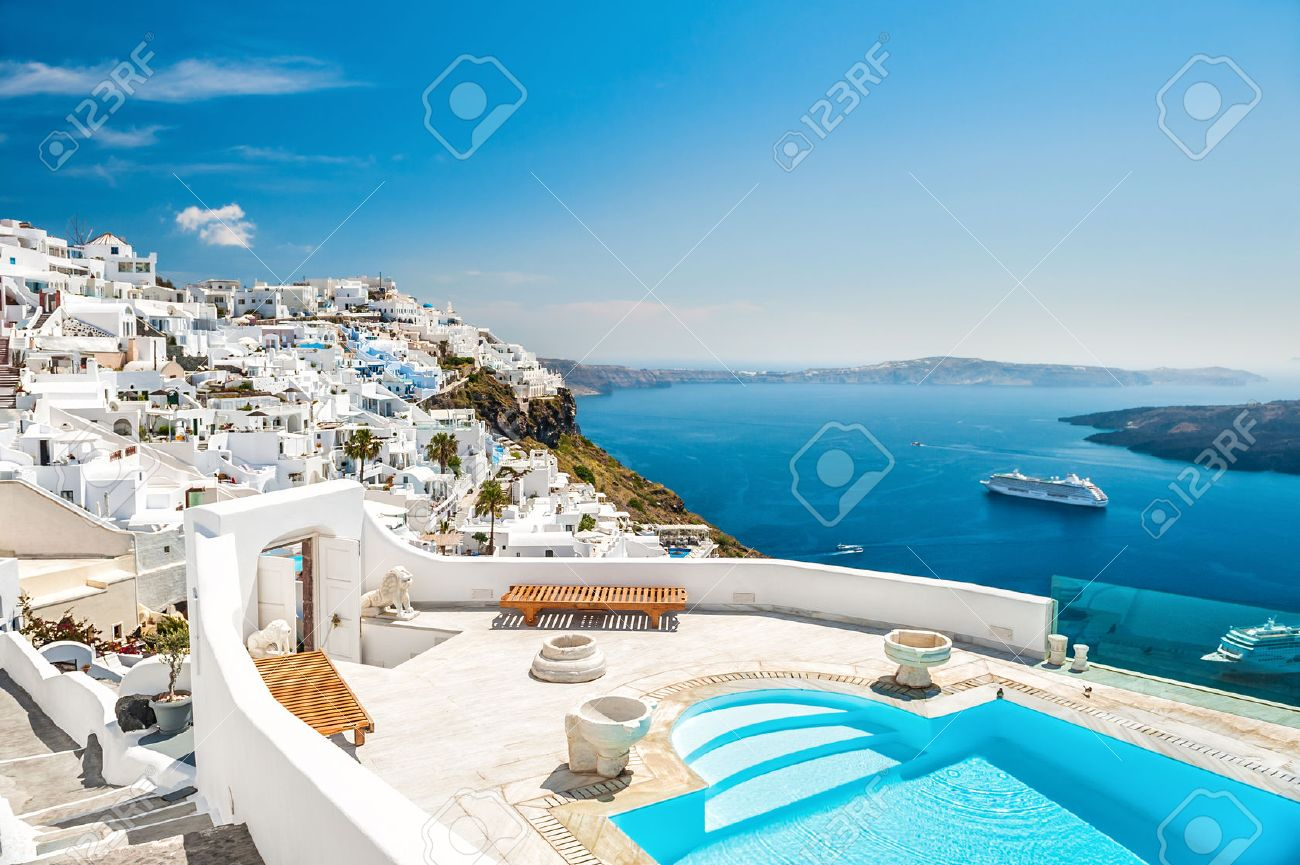 White Architecture On Santorini Island, Greece. Swimming Pool In Luxury  Hotel. Beautiful View