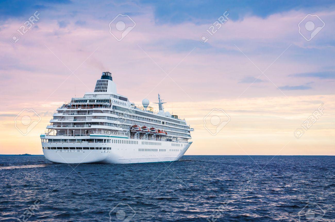 Big Cruise Ship In The Sea At Sunset Beautiful Seascape Stock - Big cruise ship