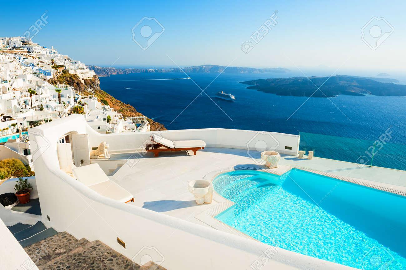 White architecture on Santorini island, Greece. Luxury swimming pool with sea view. Famous travel destination - 165551639
