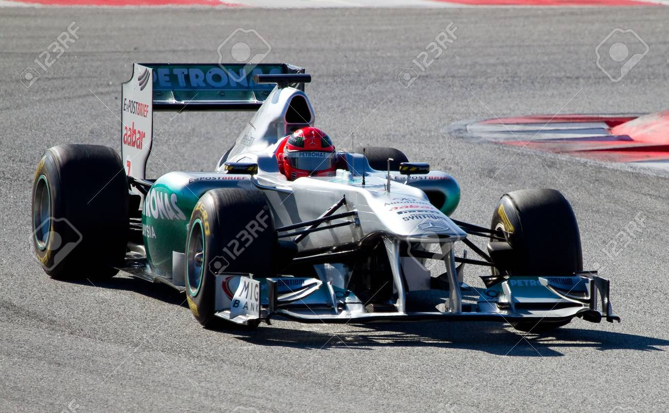 BARCELONA, SPAIN - FEBRUARY 18, 2011: Michael Schumacher of Mercedes team driving his F1 car during Formula One Teams Test Days at Catalunya circuit. Stock Photo - 11542946