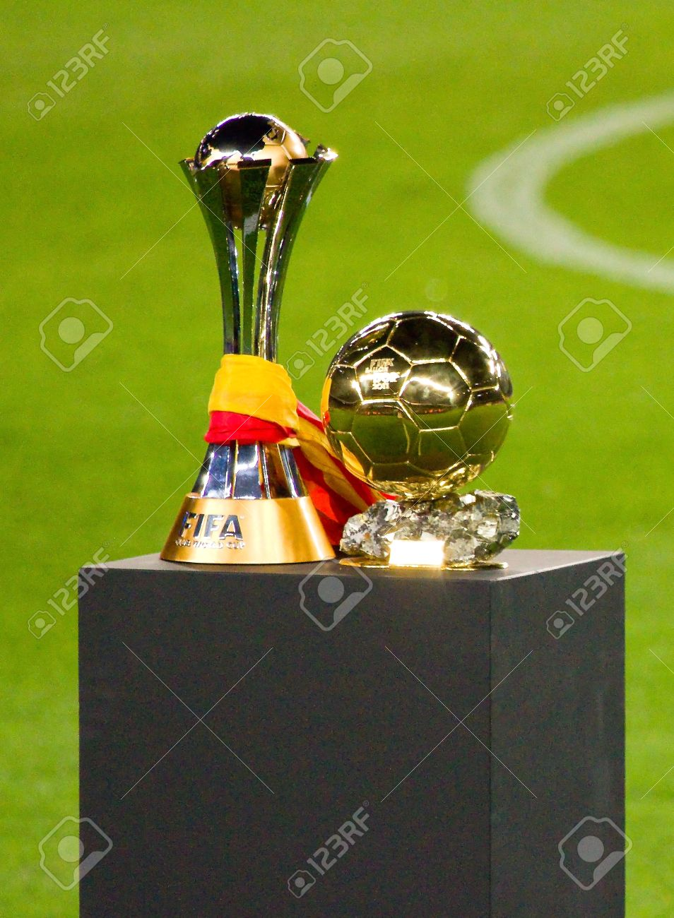 BARCELONA - JANUARY 15, 2012: FC Barcelona team offers the FIFA Club World Cup (L) and FIFA World Player Gold Ball Trophy to supporters, in Camp Nou stadium. Stock Photo - 12058610
