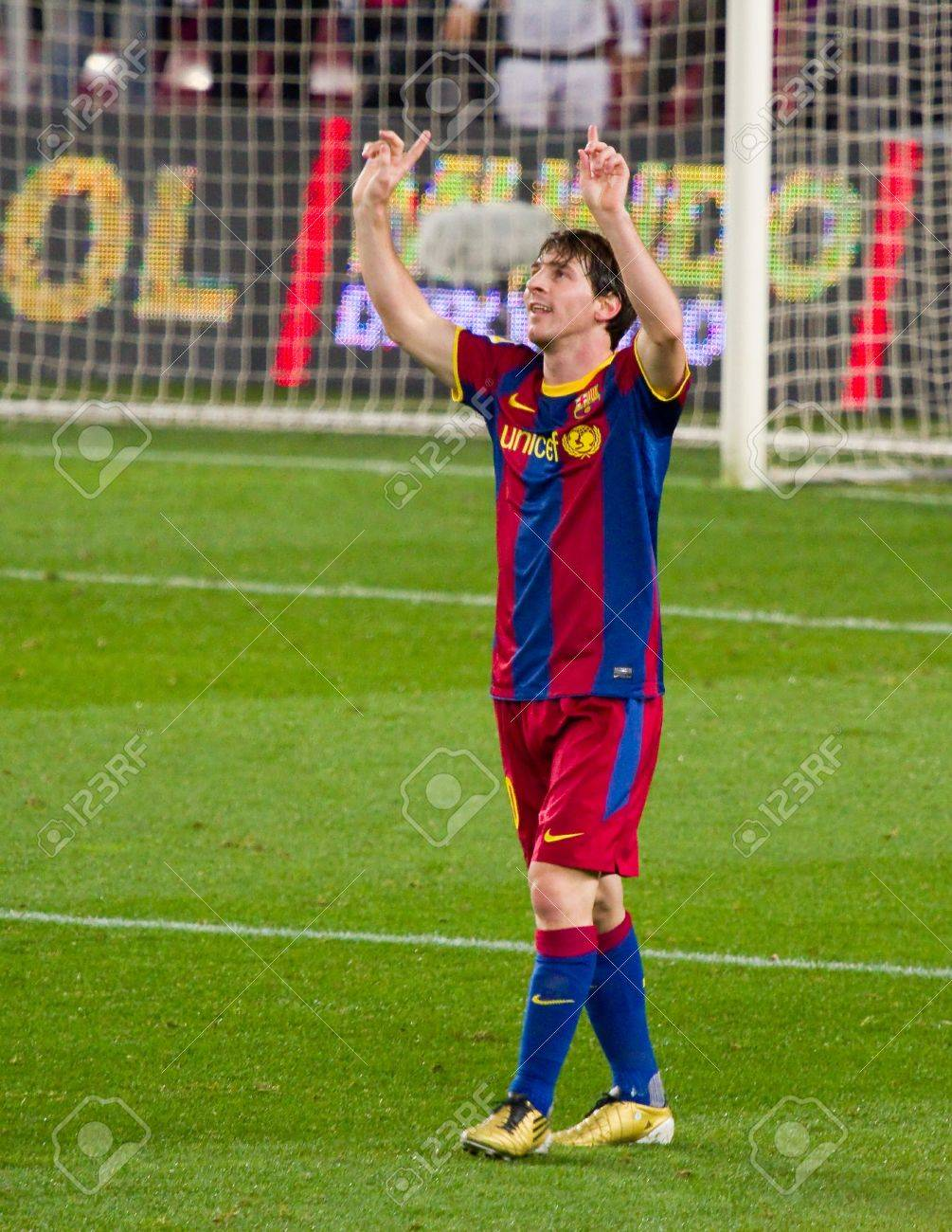 BARCELONA - JANUARY 12: Lionel Messi celebrating a goal during football Spanish Cup match between FC Barcelona and Real Betis, final score 5 - 0. January 12, 2011 in Barcelona, Spain Stock Photo - 13685453