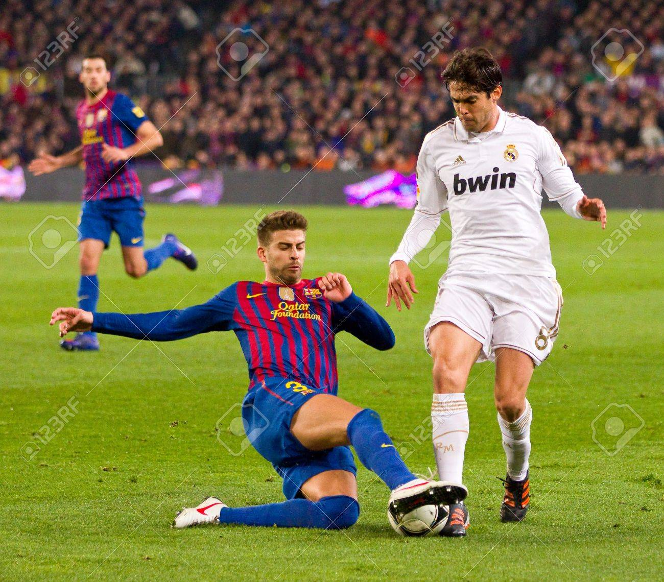 BARCELONA - JANUARY 25: Gerard Pique and Ricardo Kaka in action during the Spanish Cup match between FC Barcelona and Real Madrid, final score 2 - 2, on January 25, 2012, in Barcelona, Spain Stock Photo - 14755546
